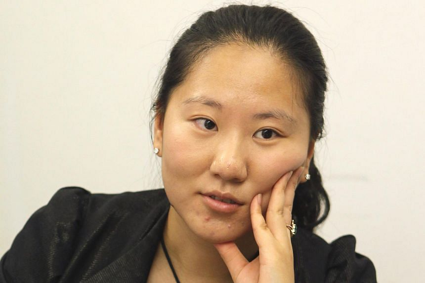 Ms Audrey Jin Yu (above), daughter of JES International's former chief executive and chairman Jin Xin, now helms the company.