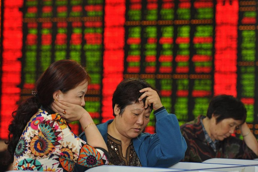Investors check share prices in a stock firm.