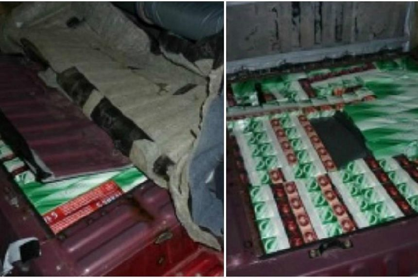 Contraband cigarettes hidden in modified floorboard of car.