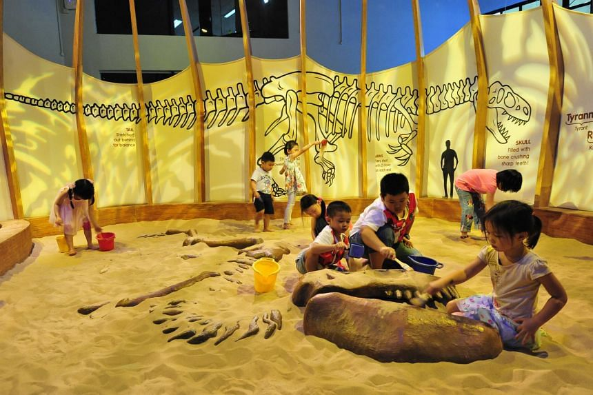 Children excavating ''dinosaur bones'' at the Dino Pit in Science Centre Singapore. Having a passionate and fun teacher who is not preoccupied with grades will go a long way towards inculcating a lifelong interest in science