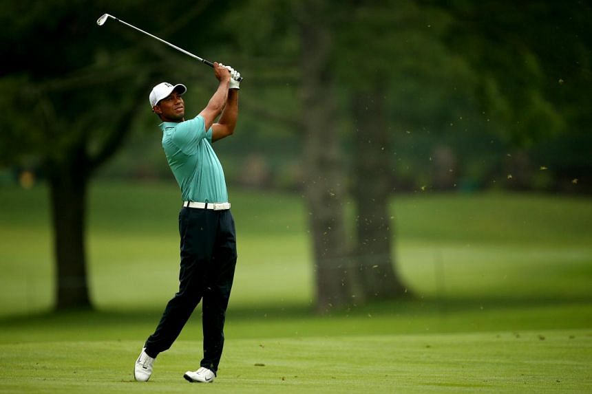 Woods takes his second shot on the 10th hole during the first round.