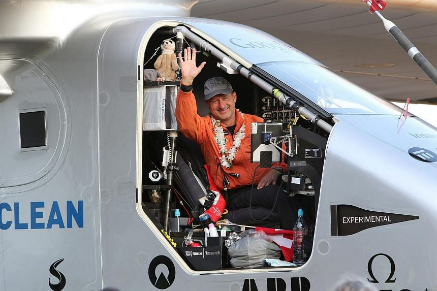 Pilot Andre Borschberg waving to the crowd after he landed the Solar Impulse 2 airplane at Kalaeloa airport.
