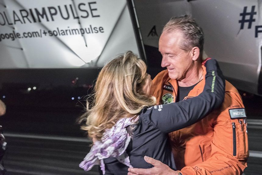Pilot Andre Borschberg (right) and his wife Yasmine before the Swiss-made solar-powered plane Solar Impulse 2 takes off from the international airport in Nagoya, Japan.