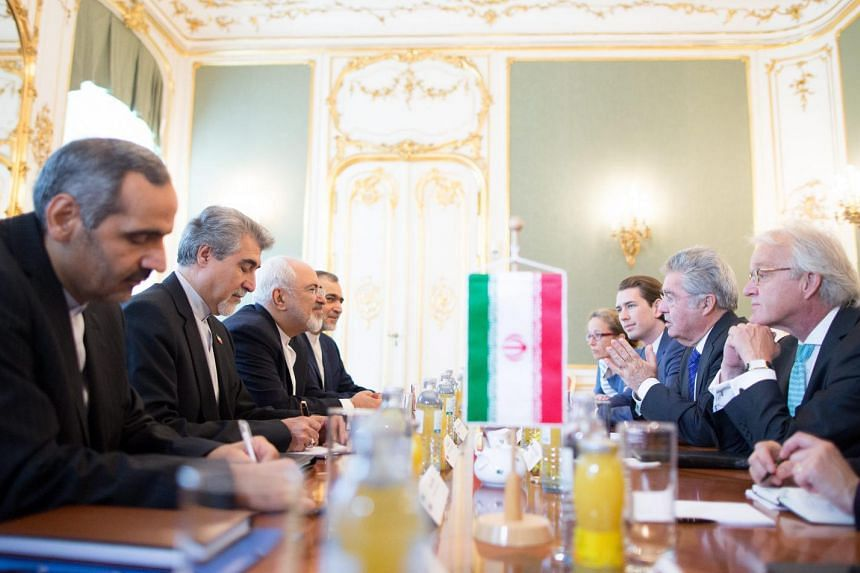 Iranian Foreign Minister Mohammad Javad Zarif (3rd left), Austrian President Heinz Fischer (2nd right) and Austrian Foreign Minister Sebastian Kurz (3-R) sit for a meeting in Vienna, Austria, on July 3, 2015.