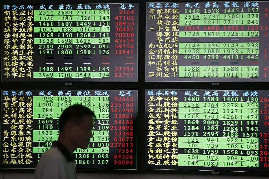 An electronic screen at a brokerage house in Shanghai yesterday. China stocks slumped, taking their three-week tumble to nearly 30 per cent and wiping out most of this year's gains.