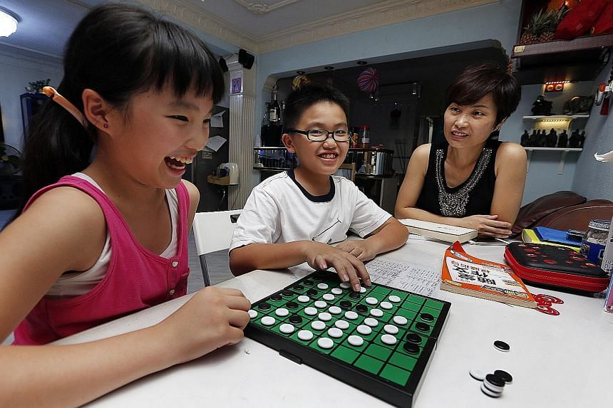 Housewife Michelle Chen admits her children's academic results are not ideal. Vivian (left) and William struggle with maths and science, but Madam Chen says the children have to tackle this problem themselves.