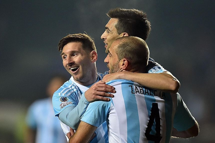 Argentina's midfielder Javier Pastore (centre) celebrating with team-mates Lionel Messi (left) and Pablo Zabaleta after scoring against Paraguay in the semi-final. Argentina can bounce back quickly from last year's World Cup disappointment with a Cop