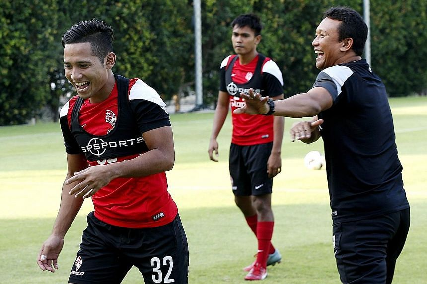 LionsXII forward Sahil Suhaimi (left) sharing a joke with coach Fandi Ahmad during training at the Geylang field. The Singapore side were winless in their last two MSL games.