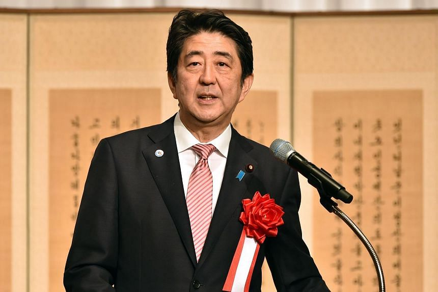 Japanese Prime Minister Shinzo Abe delivering a speech.
