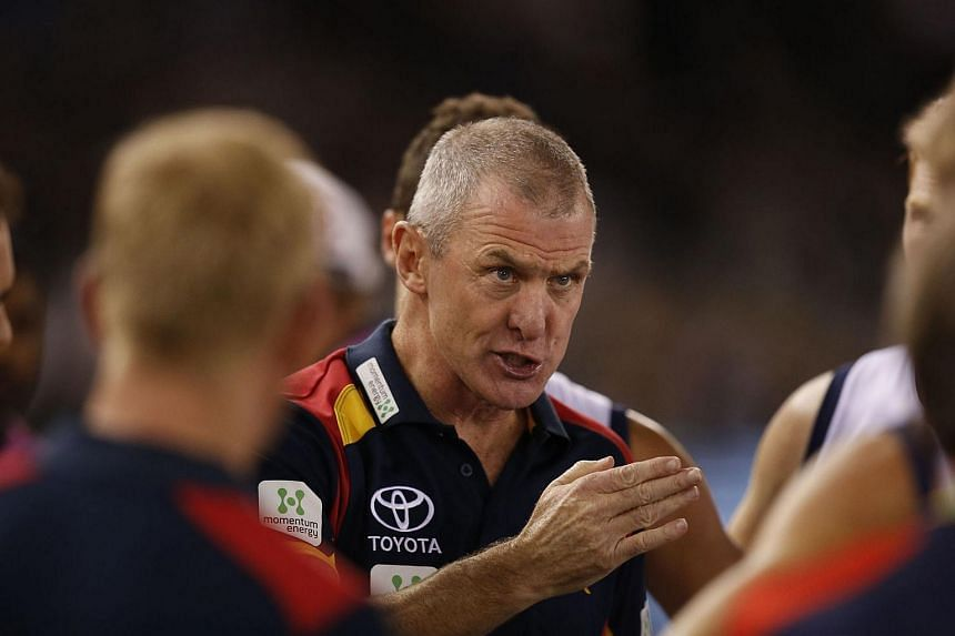 Phil Walsh (centre), senior coach of the Australian Football League's (AFL) Adelaide Crows, during an AFL match between the Collingwood Magpies and the Crows at Etihad Stadium in Melbourne.