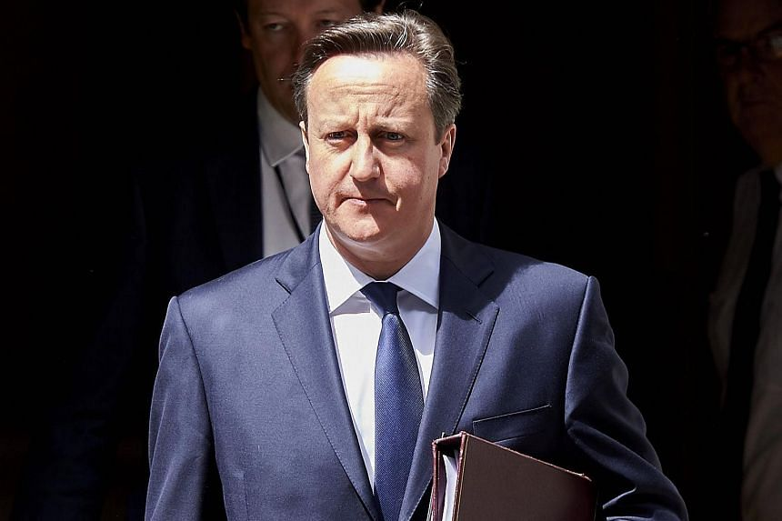 British PM David Cameron leaves 10 Downing Street in London.