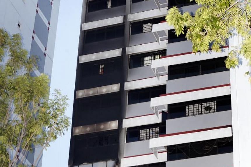 When The Straits Times visited the scene at Block 699B, Hougang Street 52, at least four other units above the ninth-floor unit, where the fire broke out, were blackened on the outside.