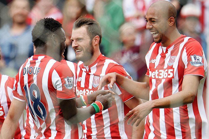 Stoke City's Steven N'Zonzi celebrating after scoring their fifth goal with Mame Biram Diouf.