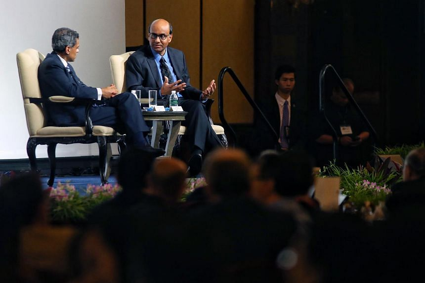 DPM Tharman Shanmugaratnam (right) speaking at the conference.