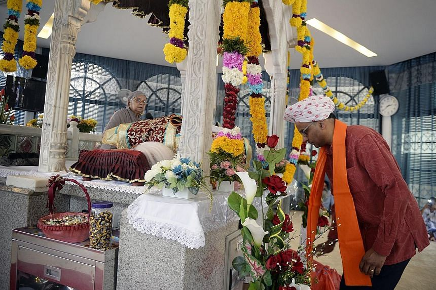 Deputy Prime Minister Tharman Shanmugaratnam paying his respects at the Bhai Maharaj Singh Memorial Temple during the Bhai Maharaj Singh Festival at the Silat Road Sikh Temple yesterday.