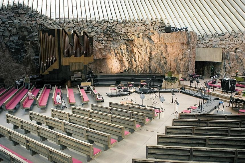 Temppeliaukio Church (Rock Church, above) is excavated into solid rock, while a Nordic walk (below) with skiing poles is a good way to explore the city and its suburbs.