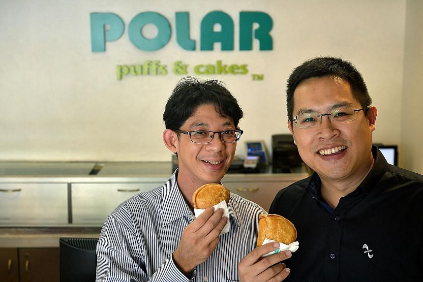 Polar Puffs & Cakes directors Calvin Chan (above left), with his cousin Jonathan Cheah. Their baked curry puff is loaded with chicken meat encased in flaky puff pastry.