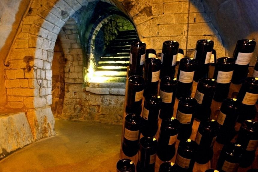 Bottles in a cellar and Gallo-Roman chalk pits in Reims, France.