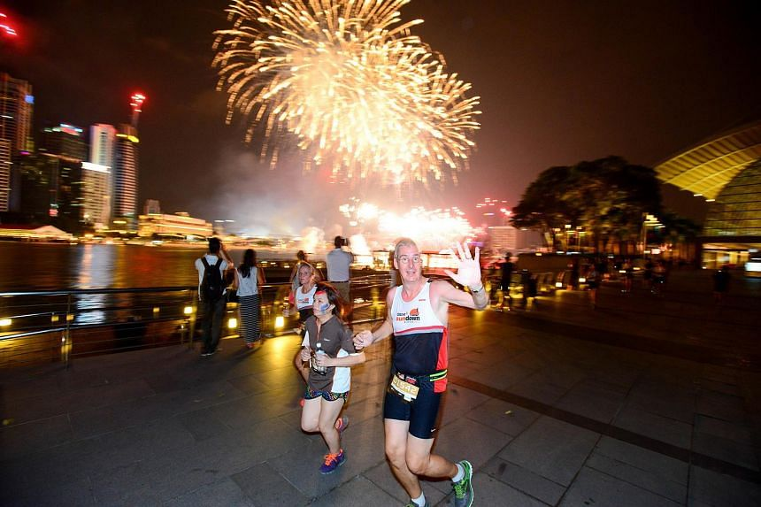 Participants of the 5km fun run with scenic landmarks and a fireworks display to contend with during the OSIM Sundown marathon.