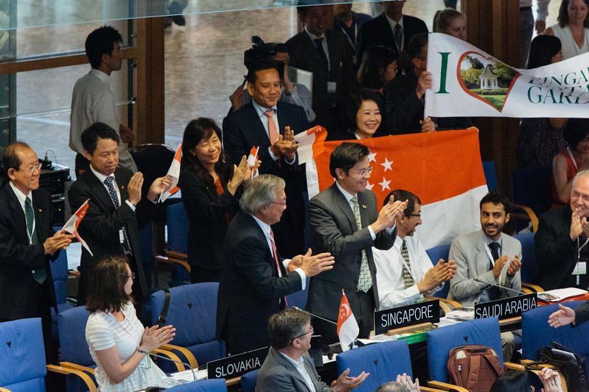Minister for Culture, Community and Youth Lawrence Wong (standing behind the placard Singapore), and chairman of the Singapore National Commission for Unesco, with his team at the 39th World Heritage Committee meeting in Bonn, Germany on July 4, 2015