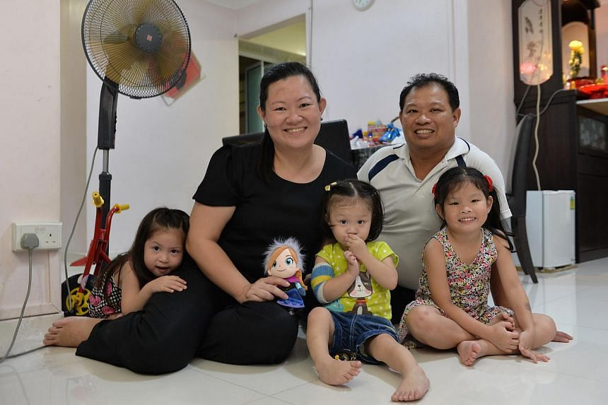 Madam Yeo and her husband with their three daughters (from left) Hwee Him, 4, Hwee Suan, 19 months, and Hwee Ling, 5.