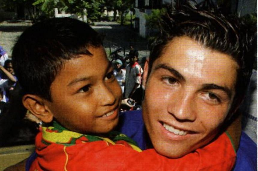 Ronaldo, then with Manchester United, meeting seven-year-old Martunis, who spent 19 days after the tsunami all by himself.