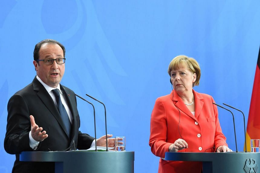 This photo taken on May 19, 2015 in Berlin shows French President Francois Hollande (left) and German Chancellor Angela Merkel after their meeting at the Chancellery.