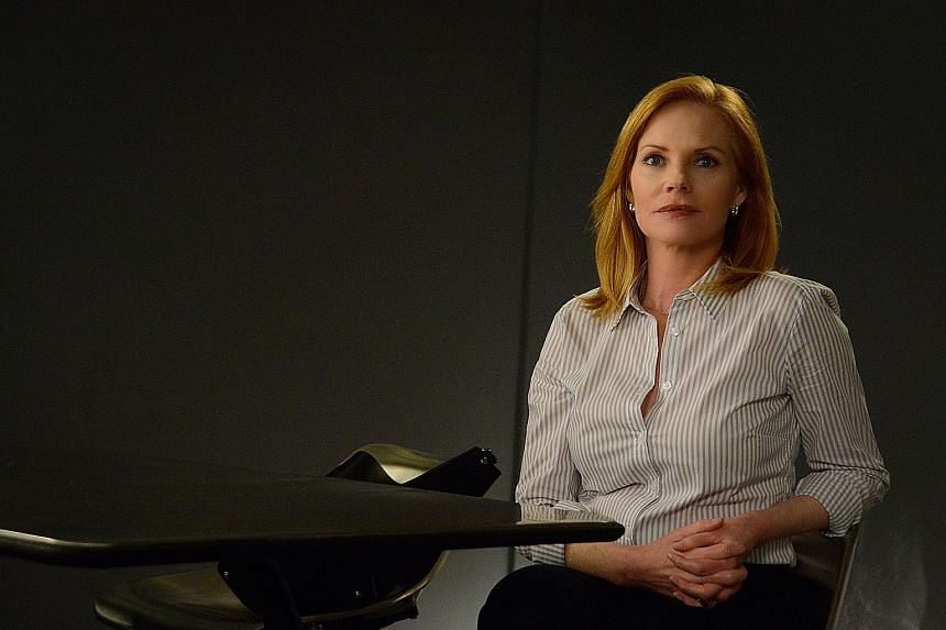 Marg Helgenberger (above) of CSI fame plays a mysterious therapist in Season 3 of Under The Dome (left).