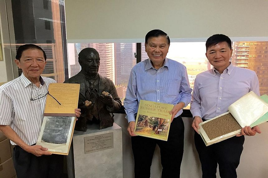 Rubber pioneers (from left) Teddy Chua, Peter Tan and Lim Kok Eng beside a bust of the gardens' first scientific director, Sir Henry Nicholas Ridley, at the Rubber Trade Association of Singapore's office. Mr Tan is holding a book he has written on ru