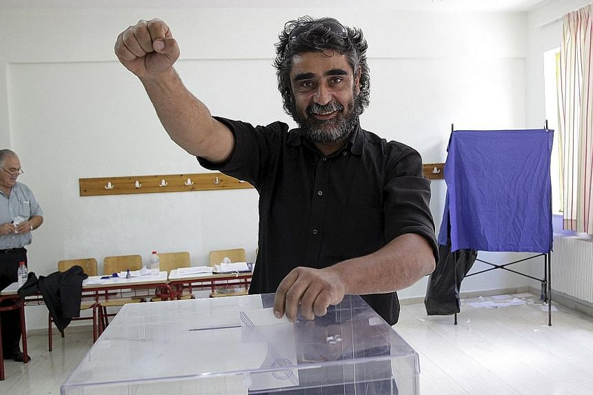 A Greek on the island of Crete casting his vote yesterday.