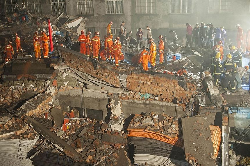 Rescuers looking for survivors among the debris of the collapsed shoe factory in the city of Wenling in Zhejiang province.