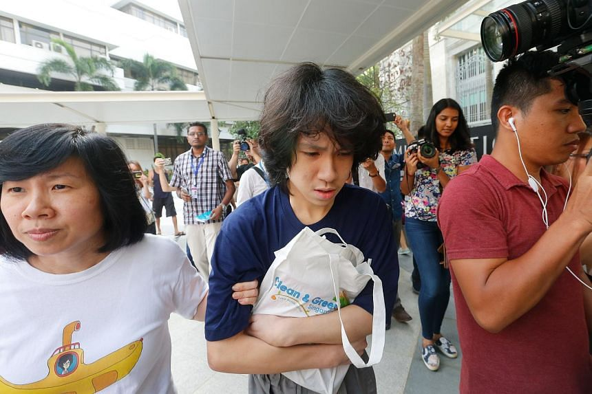 Teen blogger Amos Yee (centre) leaving the court with his mother Mary Toh (left).