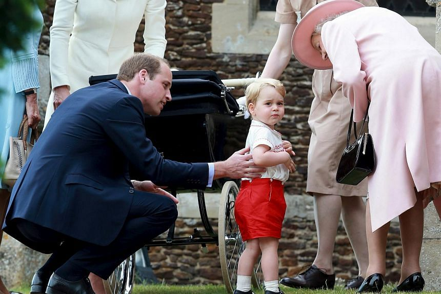 Prince George of Cambridge talks to Queen Elizabeth outside the Church of St Mary Magdalene on the Sandringham Estate for the Christening of Princess Charlotte of Cambridge.