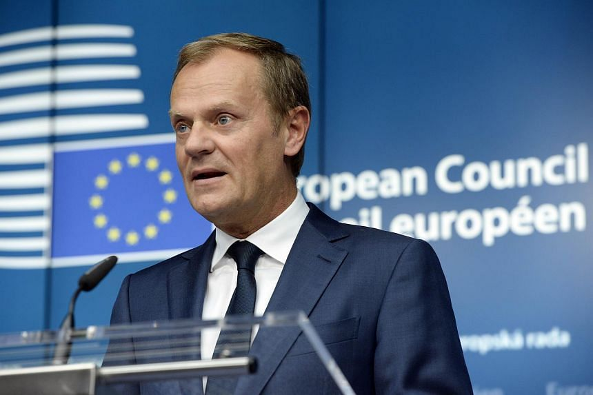 European Union Council President Donald Tusk addresses journalists at the end of a European Summit at the EU Council building in Brussels.