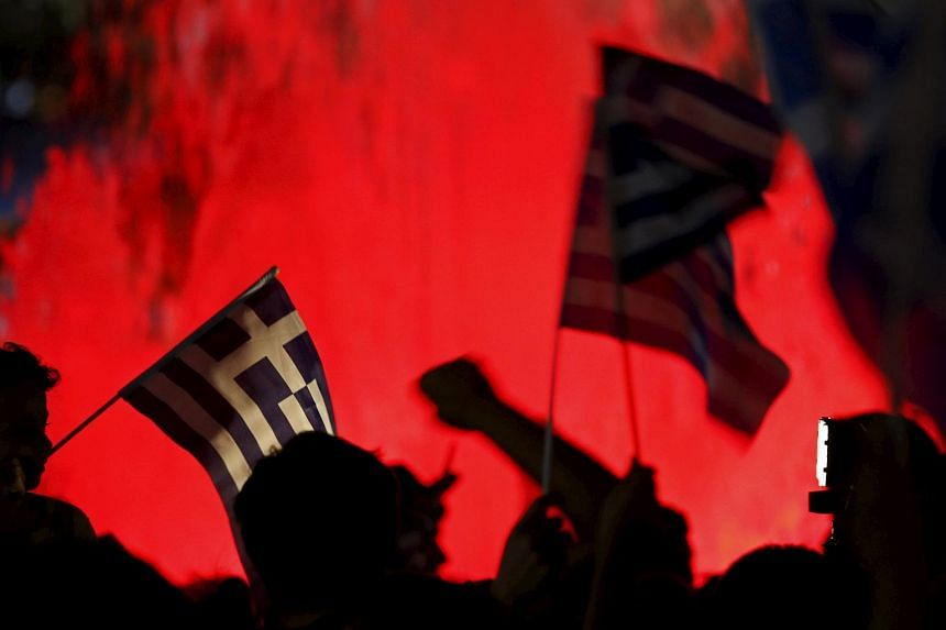 'No' supporters wave Greek national flags on the main Constitution (Syntagma) square in Athens, Greece on July 5, 2015.