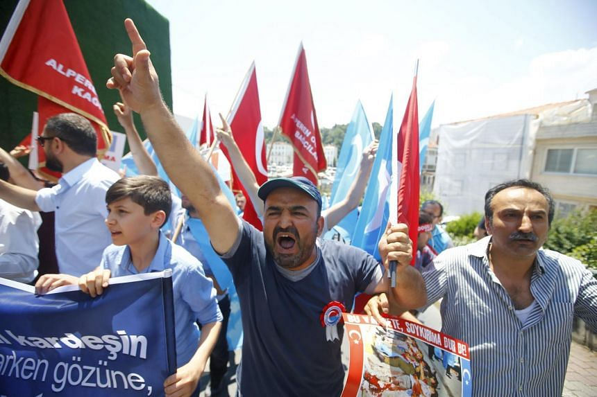 Demonstrators shout slogans during a protest against China near the Chinese Consulate in Istanbul, Turkey July 5, 2015.