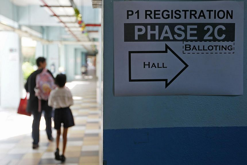 A sign directing parents to the hall for primary one registration at South View Primary School.