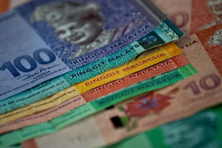 Malaysia's ringgit tumbled to the weakest level since a dollar peg was scrapped in 2005 as the heightened risk that Greece will exit the euro damped demand for emerging-market assets.