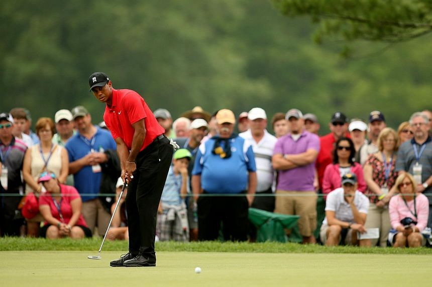 Tiger Woods putts for birdie on the eighth hole during the final round of The Greenbrier Classic.