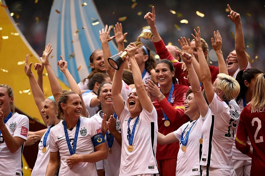 The United States celebrates after winning the Fifa Women's World Cup Canada 2015 5-2 against Japan at BC Place Stadium.