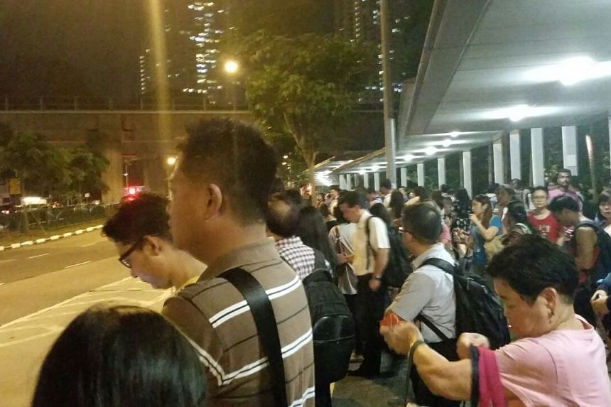 Commuters queue for buses outside Buona Vista MRT Station on July 7, 2015.