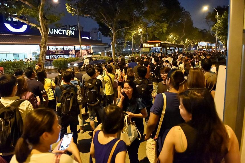 People queueing up for bus rides opposite Bishan station after train services on the North-South Line went down on Tuesday evening, July 7, 2015.