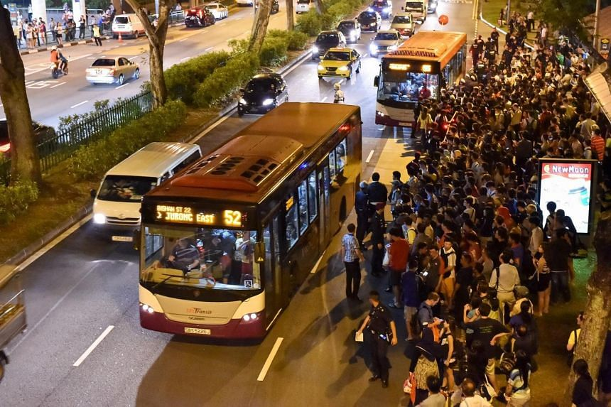 People queueing up for bus rides opposite Bishan station after train services on the North-South Line went down on Tuesday evening.