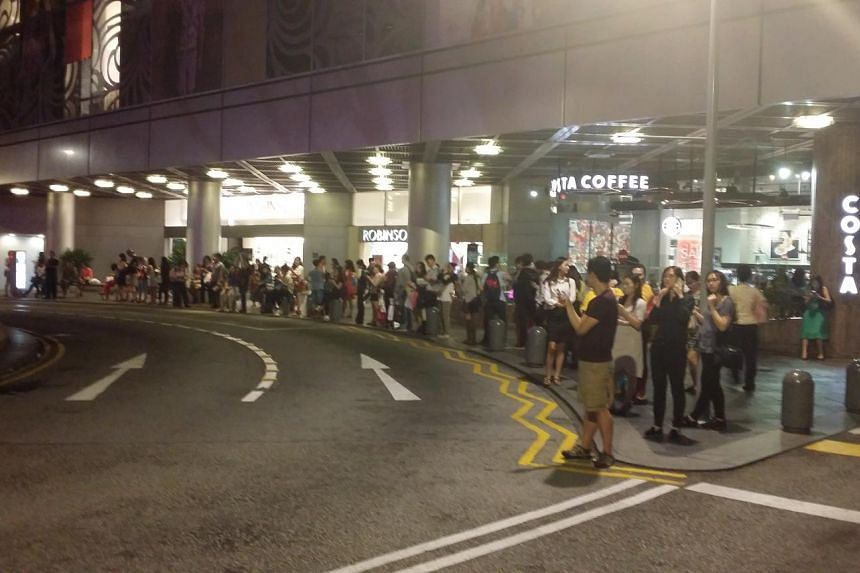 The taxi queue outside Raffles City Shopping Centre on July 7, 2015, after the train disruption.