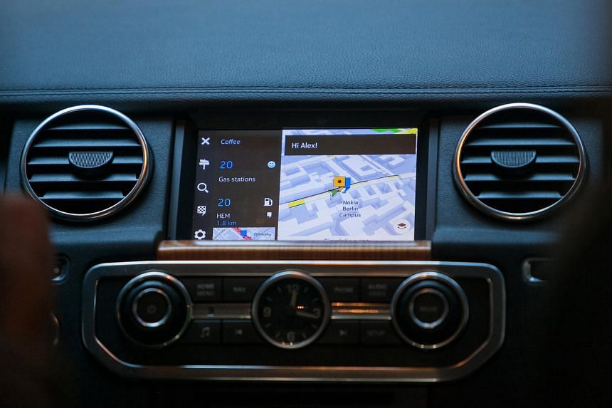 An automobile dashboard monitor displays HERE software, the connected driving maps unit of Nokia Oyj, in Berlin, Germany, on Thursday, April 23, 2015.