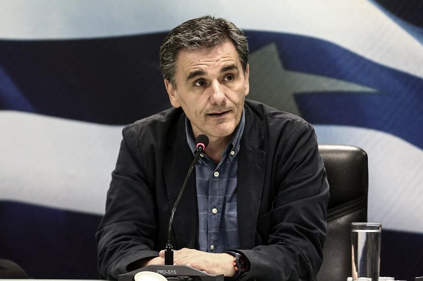 Euclid Tsakalotos, Greece's finance minister, addresses journalists during a handover ceremony in Athens, Greece, on Monday, July 6, 2015.