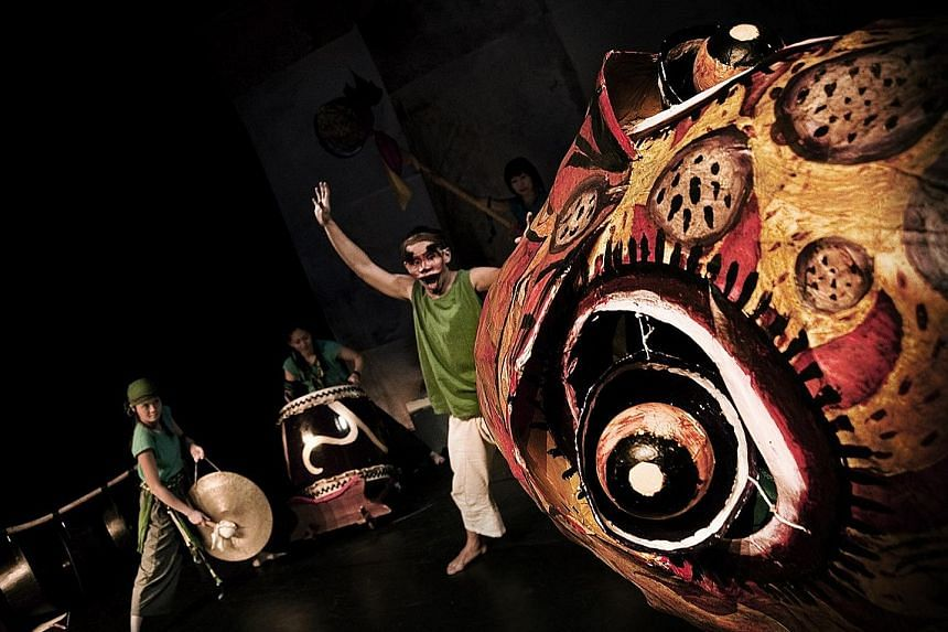 Into The Flood (left) is an environmental parable that incorporates ethnological music, puppetry and masks. Veteran stage actor Yong Ser Pin (centre), with performer Kuo Jing Hong (far left) and director Liu Xiaoyi (left).