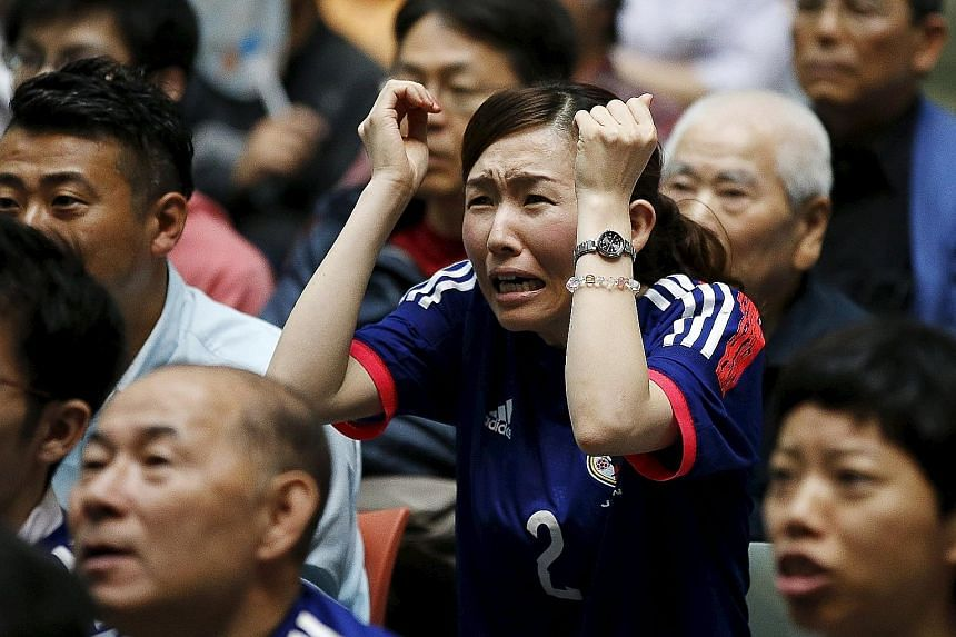 Fans, including those watching the final at a public viewing event in Tokyo, hailed the Japan team's fight-back from a disastrous start.