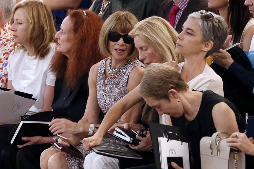 British editor-in-chief of Vogue magazine Anna Wintour (centre) attends the show.