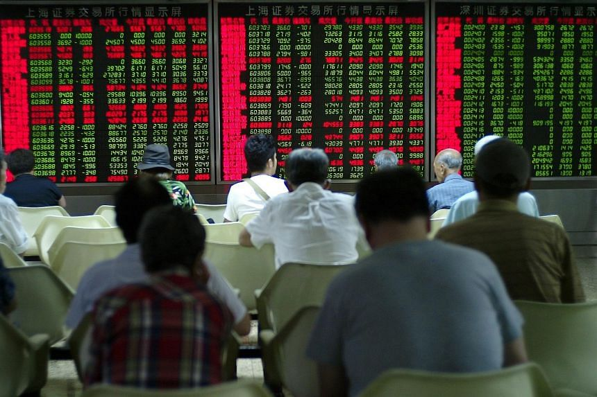 Nurulnadiah Mohamed Noh: Investors sitting in front of an electronic screen showing stock prices in Beijing.